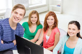 Group of smiling students having discussion — Stock Photo