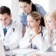 Group of doctors looking at tablet pc — Stock Photo #47463057