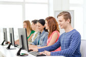 Male student with classmates in computer class — Foto Stock