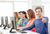 Male student with classmates in computer class — Stock Photo