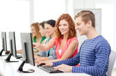 Female student with classmates in computer class — Stock Photo