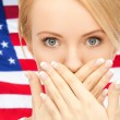 Woman with hands over mouth — Stock Photo #47501999