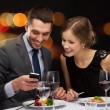 Smiling couple eating main course at restaurant — Stock Photo #47541297
