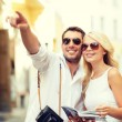 Couple with map, camera and travellers guide — Stock Photo #47543787