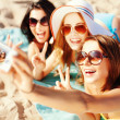Girls taking self photo on the beach — Stock Photo #47546541
