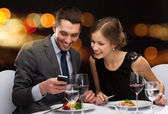 Smiling couple eating main course at restaurant — Stock Photo