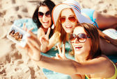 Girls taking self photo on the beach — Stock Photo