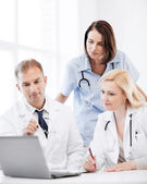 Doctors looking at laptop on meeting — Stock Photo