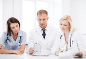 Team or group of doctors on meeting — Stock Photo