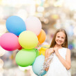 Happy girl with colorful balloons — Stock Photo #47642165
