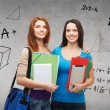 Two smiling students with bag, folders and tablet — Stock Photo #47836053