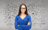 Smiling businesswoman or student in glasses — Stock Photo
