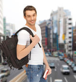 Travelling student with backpack and book — Stock Photo