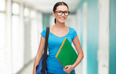Smiling student with bag and folders — Foto Stock