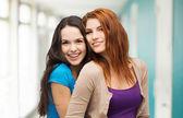 Two laughing girls hugging — Stock Photo