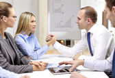 Businesswoman and businessman arm wrestling — Stock Photo