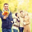 Group of friends having fun in autumn park — Stock Photo #47856925