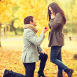 Man proposing to a woman in the autumn park — Stock Photo #47857731