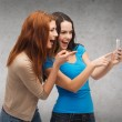 Two smiling teenagers with smartphone — Stock Photo #47888219