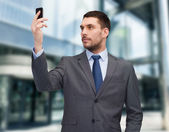 Young businessman with smartphone — Stock Photo