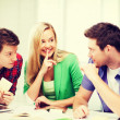 Group of students gossiping at school — Stock Photo #47909879