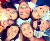 Group of teenagers looking down — Stock Photo