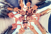 Group of teenagers showing finger five — Stock Photo