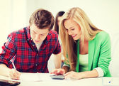 Students doing mathematics at school — Stock Photo