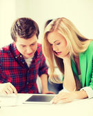 Students looking at tablet pc at school — Stock Photo