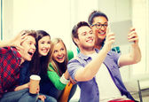 Students making picture with tablet pc at school — Stock Photo