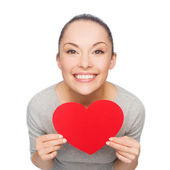 Smiling asian woman with red heart — ストック写真