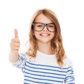 Little girl with black eyeglasses — Стоковое фото