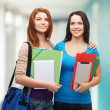 Two smiling students with bag, folders and tablet — Stock Photo #47933567
