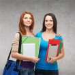 Two smiling students with bag, folders and tablet — Stock Photo #48246705