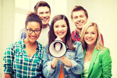 Group of students with megaphone at school — Stock Photo