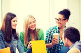 Students communicating and laughing at school — Stock Photo