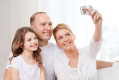 Happy family with little girl making self portrait — 图库照片