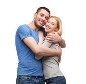 Smiling couple hugging — Stock Photo