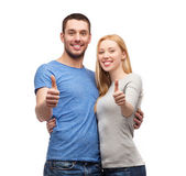 Smiling couple showing thumbs up — Stock Photo