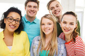Group of smiling people at school or home — Stock Photo