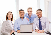 Business team working with laptop in office — Stock Photo