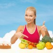 Woman pointing at healthy food — Stock Photo #48266649
