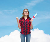 Smiling female student in eyeglasses with diploma — Stock Photo