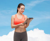 Sporty woman with tablet pc computer — Stock Photo