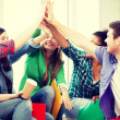 Students giving high five at school — Stock Photo #48331911