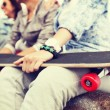 Close up of female hand holding skateboard — Foto de Stock