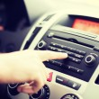 Man using car audio stereo system — Stock Photo