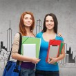 Two smiling students with bag, folders and tablet — Stock Photo #48338741