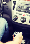 Man shifting the gear on car manual gearbox — Stock Photo