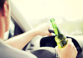 Man drinking alcohol while driving the car — Stock Photo